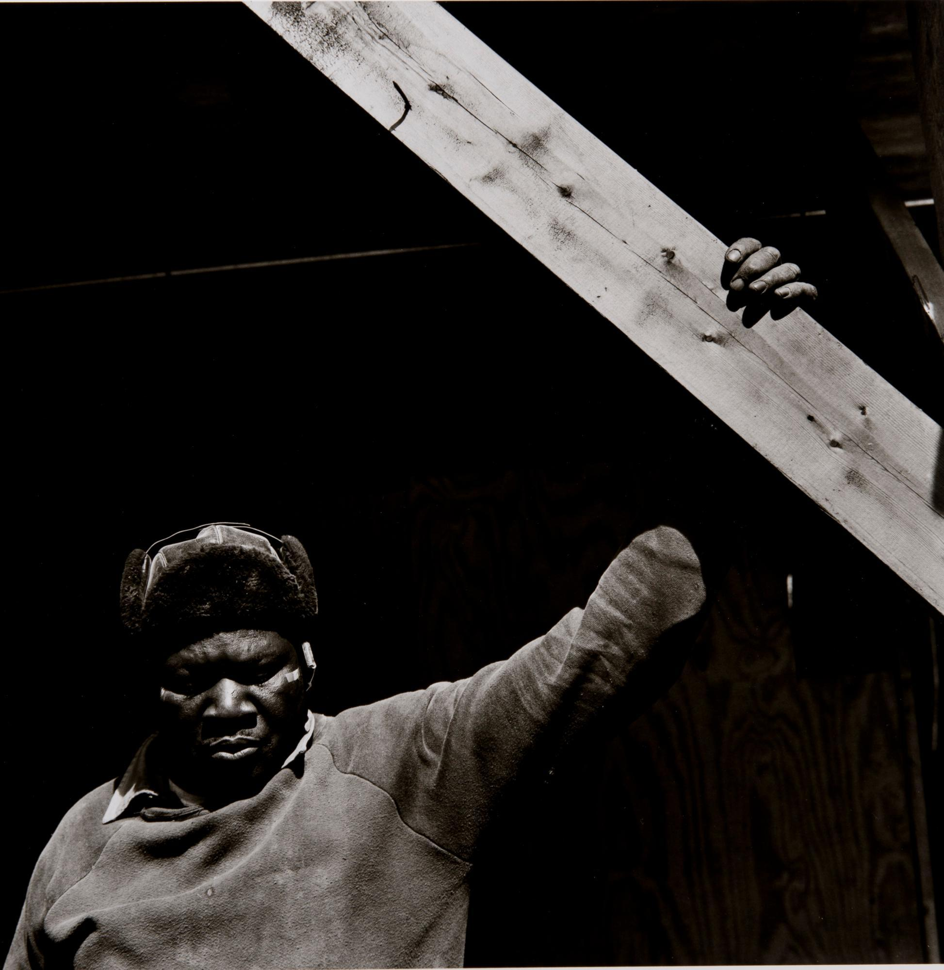 Workers series (man holding wood)